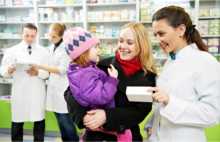 Pharmacist talking to a mother and her child