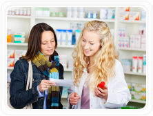 A pharmacy customer talking to a pharmacist about her prescription