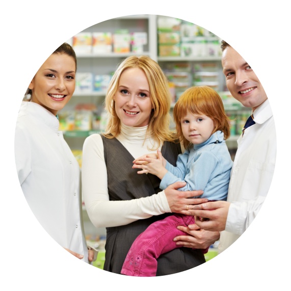 A mother carrying a child standing in between two pharmacist